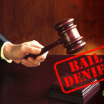 "Judge striking gavel with ""Bail Denied"" caption"