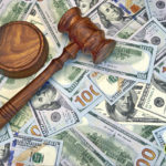 Judge's Gavel on a pile of cash